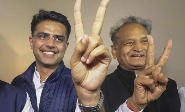 Congress leaders Ashok Gehlot (R) and Sachin Pilot (C) flash victory signs after the declaration of Rajasthan Assembly election result, in Jaipur, Tuesday, Dec. 11, 2018. (PTI Photo)