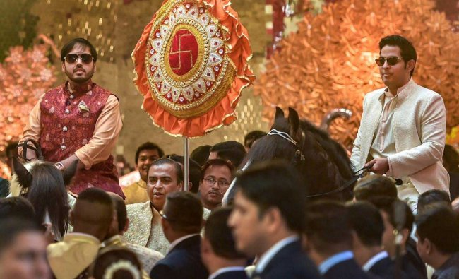 Industrialist Mukesh Ambani with sons Anant and Akash wait for the arrival of the groom, Anand Piramal, at their residence, Antilla, on the wedding day, in Mumbai, Wednesday, Dec. 12, 2018. (PTI Photo)