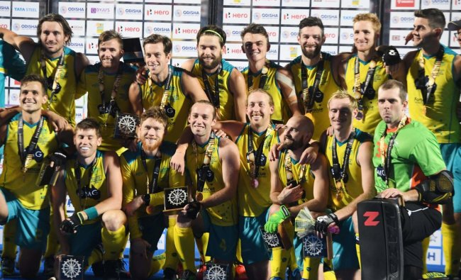 Australia\'s players pose for photograph with their bronze medal after their field hockey bronze medal match between England and Australia at the 2018 Hockey World Cup in Bhubaneswar on December 16, 2018. (AFP)