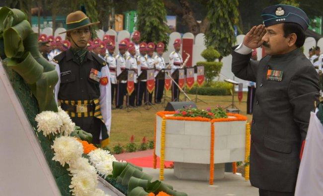 Former Air Chief Marshal Arup Raha (Retd) pays homage to the martyrs of 1971 Indo-Pakistan war on the ocassion of Vijay Diwas at Vijay Smarak, Fort William (Eastern command Headquarter), in Kolkata, Sunday, Dec. 16, 2018. (PTI)