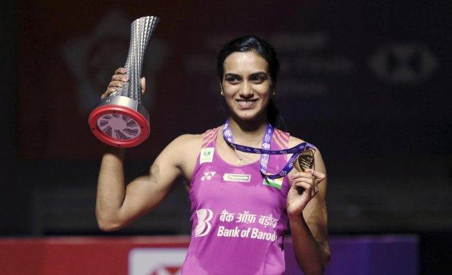 Pusarla V. Sindhu of India holds the winner\'s trophy after beating Nozomi Okuhara of Japan in their women\'s badminton singles final at the BWF World Tour Finals in Guangzhou in southern China\'s Guangdong province, Sunday, Dec. 16, 2018. AP/PTI
