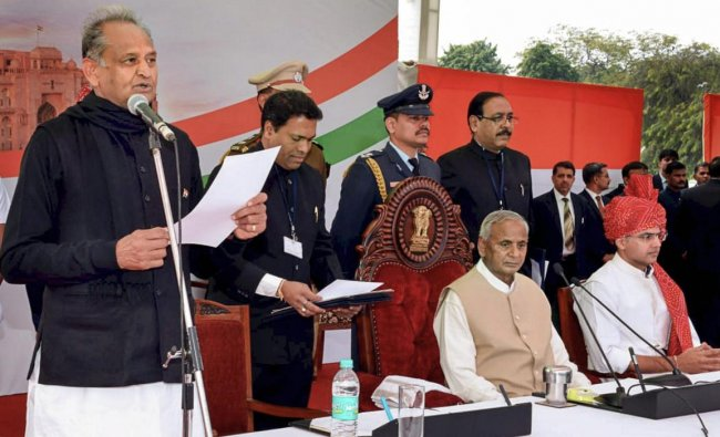 Rajasthan Chief Minister Ashok Gehlot being administered the oath of office as Governor Kalyan Singh and newly-elected Rajasthan Deputy Chief Minister Sachin Pilot look on, at Albert Hall, in Jaipur, Monday, Dec. 17, 2018. (PTI Photo)