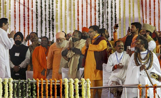 Newly sworn-in Madhya Pradesh Chief Minister Kamal Nath greets various religious leaders who attended his swearing-in-ceremony, in Bhopal, Monday, Dec. 17, 2018. (PTI Photo)