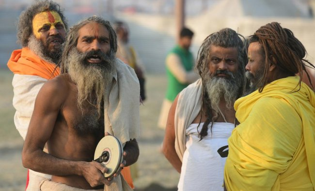 Indian sadhus of Digamber Akhada mark their land during the land allotment of the Kumbh Mela festival, on the bank of the Gange river in Allahabad on December 19, 2018. - The Kumbh Mela in the town of Allahabad will see millions of Hindu devotees gather from January 15, 2019 to March 4, 2019 to take a ritual bath in the holy waters, believed to cleanse sins and bestow blessings. (Photo by SANJAY KANOJIA / AFP)