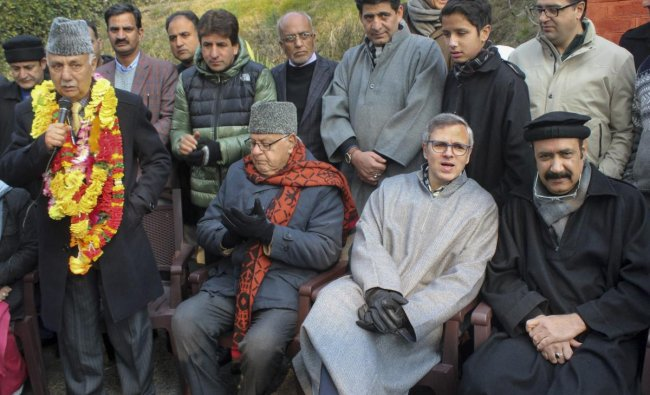 Peoples Democratic Party (PDP) leaders and former legislators Basharat Bukhari and Peer Muhammad Hussain join National Conference in presence of the party President Farooq Abdullah and party vice-president Omar Abdullah, in Srinagar, Wednesday, Dec 19, 2018. (PTI Photo)