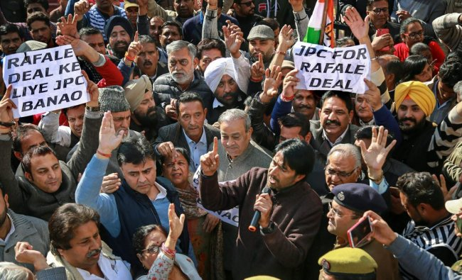 JKPCC President GA Mir with senior leaders raise slogans during a protest march in relation to Rafale Deal, in Jammu, Thursday, Dec. 20, 2018. (PTI Photo)