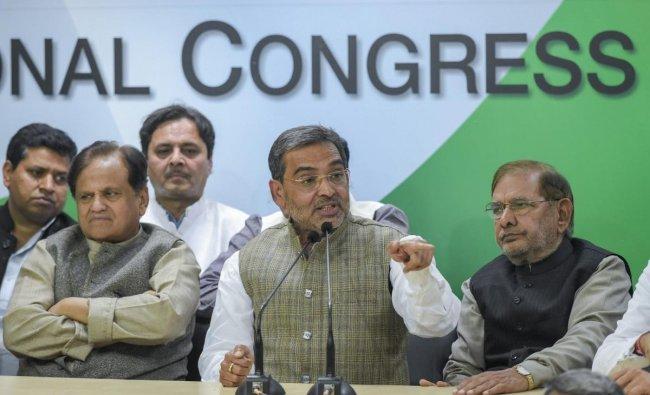Rashtriya Lok Samta Party (RLSP) leader Upendra Kushwaha (3rd R) speaks after joining the grand alliance during a press conference at AICC in New Delhi, Thursday, Dec 20, 2018. (PTI Photo/Vijay Verma)