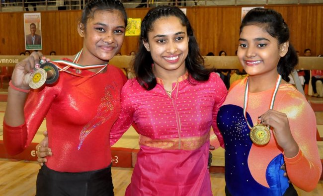 India\'s ace gymnast Dipa Karmakar flanked by winners of the 64th National Games, in Agartala, Wednesday, Dec. 19, 2018. (PTI Photo)