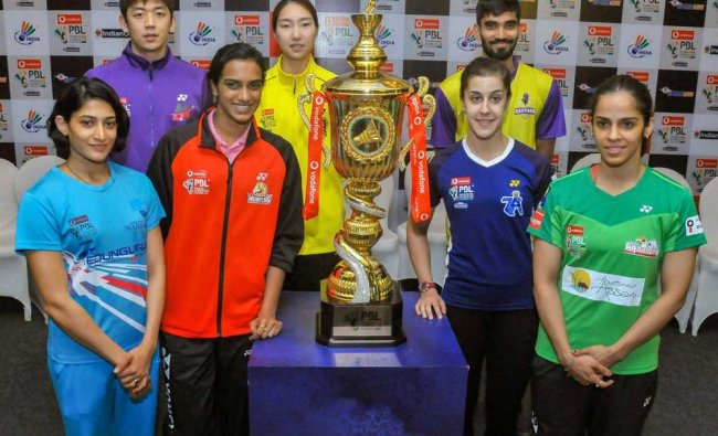 Shuttlers PV Sindhu, Saina Nehwal, Carolina Marin, A Ponappa, Srikanth Kidambi and other team captains pose for photos with the Season 4 trophy of Premier Badminton League (PBL), in Mumbai. PTI Photo
