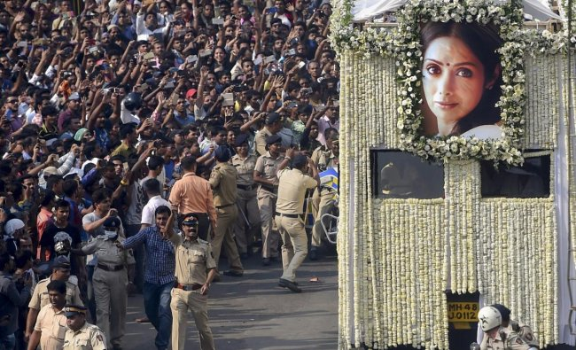 People gather in large number to pay their respect during the funeral procession of actor Sridevi, in Mumbai on February 28. Dubai Government revealed Sridevi had drowned in the hotel bathtub after losing consciousness.
