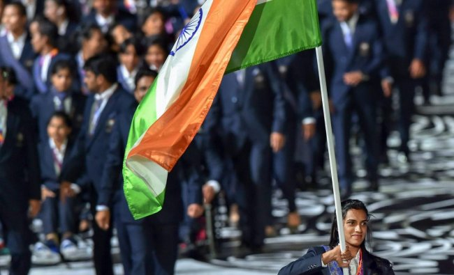 Flagbearer PV Sindhu leads the Indian contingent at Carrara Stadium during the opening ceremony of 2018 Commonwealth Games, Gold Coast in Australia, on April 4.