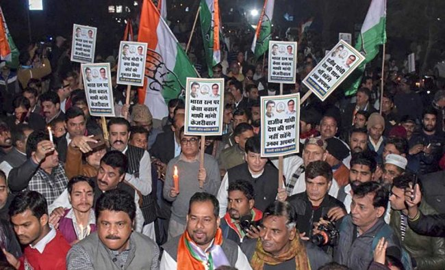 Congress Committee President Ajay Maken with party supporters protest against AAP government in relation to a resolution passed in Delhi Assembly, in New Delhi. Delhi Assembly passed a resolution demanding that Bharat Ratna awarded to former prime minister Rajiv Gandhi be withdrawn over the 1984 anti-Sikh riots. PTI Photo