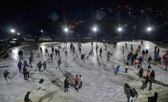 People enjoy skating at an ice-skating rink in Shimla. PTI Photo