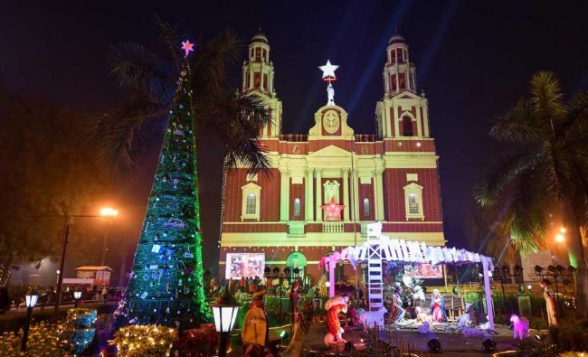 A scene at the Sacred Heart Cathedral on the eve of Christmas Day in New Delhi. PTI Photo