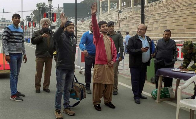 Released Pakistani prisoners Abdullah Khan and Mohammad Imran Qureshi Warsi wave as they leave for their country through Wagah border, about 35 km from Amritsar, Wednesday, December 26, 2018. They were released by the Indian authorities as a goodwill gesture. PTI Photo