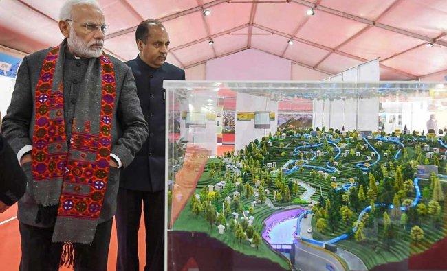 Prime Minister Narendra Modi along with Chief Minister Jai Ram Thakur visits an exhibition at Dharamshala in Himachal Pradesh. PTI Photo