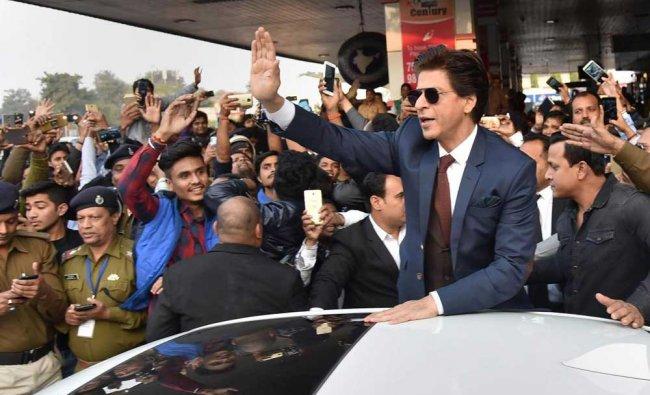 Bollywood actor Shah Rukh Khan greets fans on his arrival for his movie promotion \'Zero\', at Jai Prakash Narayan international airport, in Patna. PTI Photo