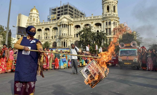 Mid-day meal workers burns a copy of the circular during a protest rally dmanding \'equal pay for equal work\', in Kolkata. PTI