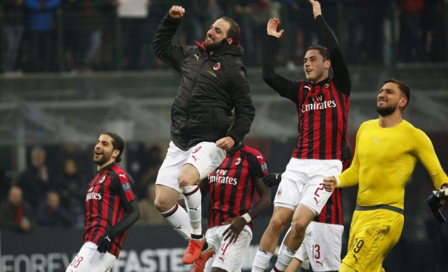 AC Milan\'s Gonzalo Higuain, center left, and his teammates celebrate at the end of a Serie A soccer match between AC Milan and Spal, at the San Siro stadium, Saturday, Dec. 29, 2018. Milan won 2-1. AP/PTI