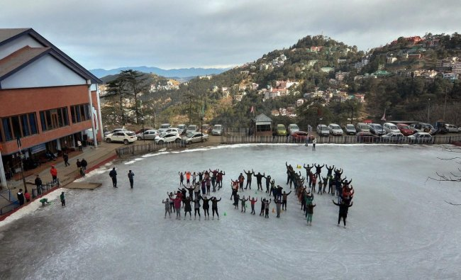Skaters form a human chain in the shape of 2019 to welcome the New Year, at Lakkar Bazar Ice Skating Rink in Shimla. PTI