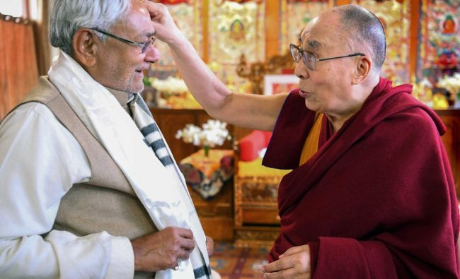 Bihar Chief Minster Nitish Kumar meets the Dalai Lama after the end of his teaching sessions, in Bodhgaya. PTI
