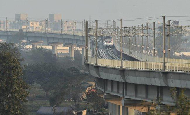 A metro train runs on the Lajpat Nagar - Mayur Vihar Pocket 1 Metro section of Delhi Metro's Pink Line, after its inauguration in New Delhi. PTI