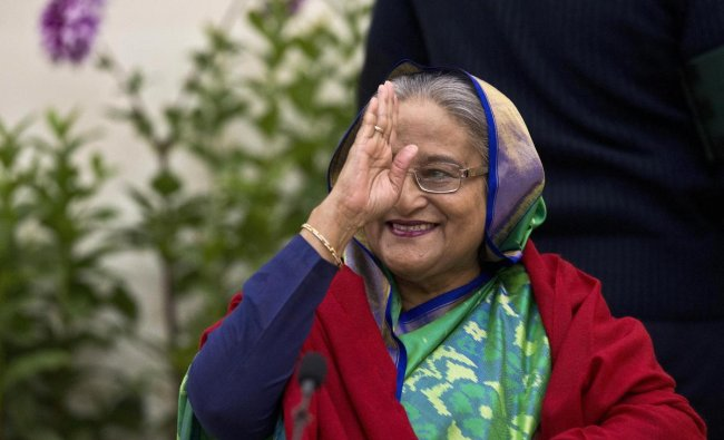 Bangladeshi Prime Minister Sheikh Hasina greets the gathering in Dhaka, Bangladesh, Monday, Dec. 31, 2018. Bangladesh\'s ruling alliance won virtually every parliamentary seat in the country\'s general election, according to official results released Monday, giving Hasina a third straight term despite allegations of intimidation and the opposition disputing the outcome. AP/PTI