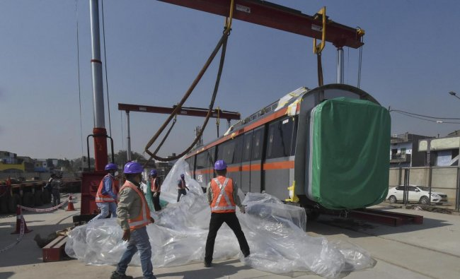 Metro train coaches for Metro-Link Express for Gandhinagar and Ahmedabad (MEGA) on their arrival in Ahmedabad. PTI