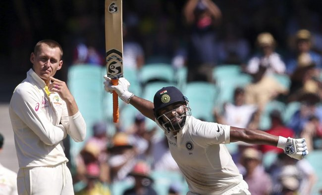 India\'s Rishabh Pant, right, celebrates making 100 runs as Australia\'s Marnus Labuschagne turns away on day 2 during their cricket test match in Sydney, Friday, Jan. 4, 2019. (AP/PTI Photo)
