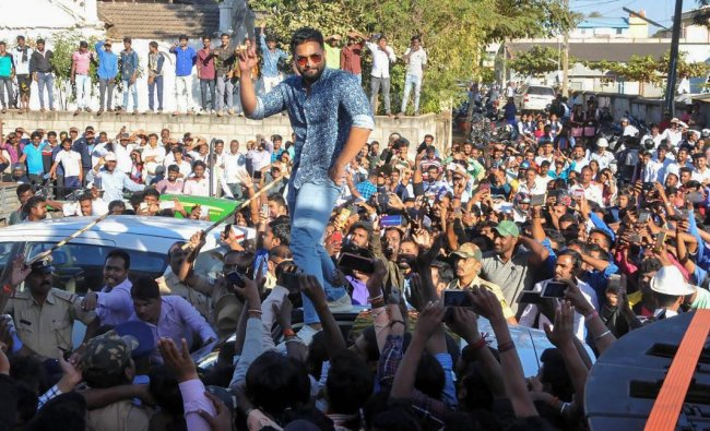 Kannada film actor Sriimurali dances as his fans look on, in Chikmagalur, Friday, Jan 4, 2019. (PTI Photo)