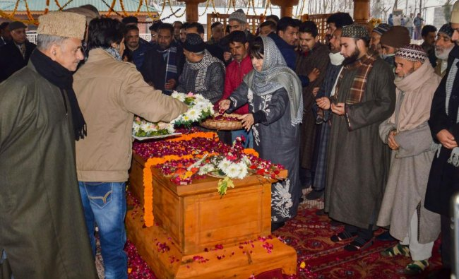 Former Jammu & Kashmir chief minister and PDP President Mehbooba Mufti along with senior party leader pays floral tribute at the grave of her father and party patron Mufti Muhammad Syed on his third death anniversarry, at Bijbehara in Anantang district of south Kashmir, Monday, Jan 7, 2019. (PTI Photo)