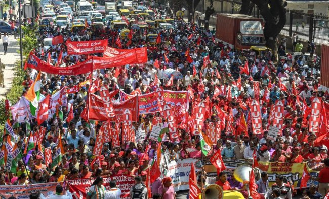 Factory workers and members of Centre of Indian Trade Unions (CITU) raise slogans during a 48-hour-long nationwide general strike called by central trade unions in protest against the \