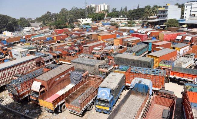 Trucks parked at Goraguntepalya Truck Terminalduring the 48-hour nationwidestrike called by Central Trade Unionsin Bengaluru on Tuesday. (DH Photo/ B H Shivakumar)