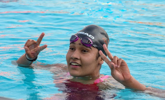 Delhi\'s Prachi Tokas reacts after winning gold medal in U-17 Girls 1500 Mtr Freestyle Swimming event at Khelo India Youth Games 2019 in Pune. PTI photo