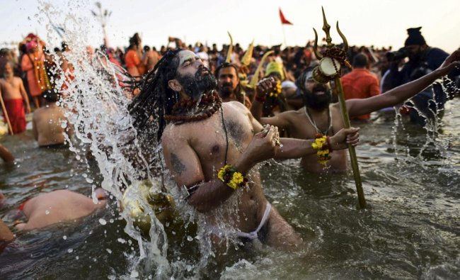 A Sadhu takes a holy dip in the water of River Narmada on the occasion of Makar Sankranti Festival in Jabalpur. PTI photo