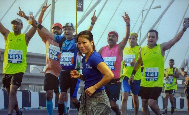 Boxer Mary Kom poses for photos during media interaction for \'TATA Mumbai marathon\' press conference, in Mumbai. PTI photo