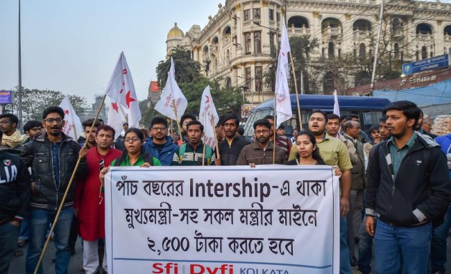 Students\' Federation of India (SFI) and Democratic Youth Federation of India (DYFI) activists raise slogans during a protest, in Kolkata. PTI photo