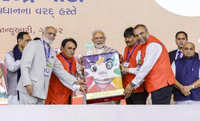 BJP supporters felicitated Prime Minister Narendra Modi at the inaugural function of Amdaavad Shopping Festival, in Ahmedabad. PTI photo
