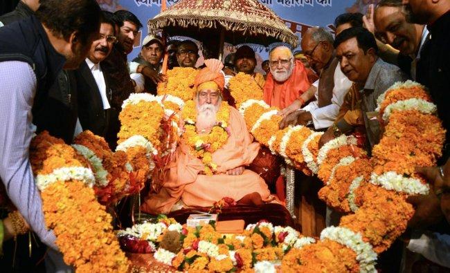 Shankaracharya Swami Swaroopanand Saraswati being garlanded during the 71th vocation daksha ceremony in Jabalpur. PTI photo
