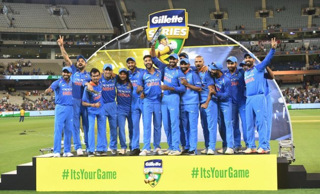 Indian cricket players pose with the Border-Gavaskar Trophy during their one day international cricket match against Australia in Melbourne, Australia. (AP/PTI Photo)