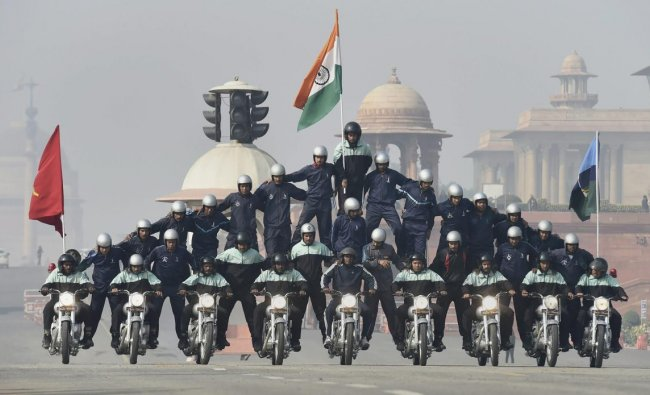 Army daredevils perform a stunt on motorcycles during rehearsals for the upcoming Republic Day parade 2019, on a cold, foggy morning, at Rajpath in New Delhi. (PTI Photo/Kamal Singh)