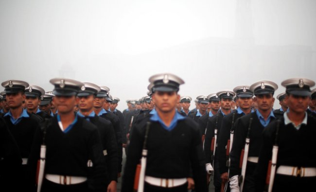 Indian Navy soldiers rehearse for the Republic Day parade on a foggy winter morning in New Delhi. (Reuters Photo)