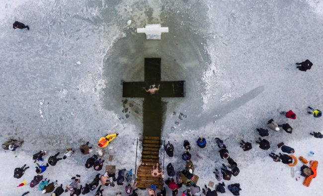An Orthodox believer bathes in the icy water on Epiphany in Kiev, Ukraine. Epiphany celebrates the revelation of Jesus Christ as the incarnation of God through his baptism in the River Jordan. (AP/PTI Photo)