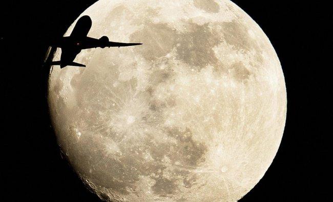 An aircraft passes the moon over Frankfurt, Germany. (AP/PTI Photo)