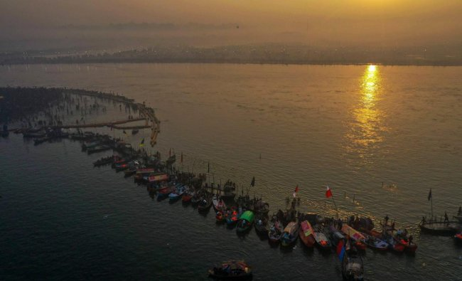 An aerial view shows devotees gathered at Sangam to take a holy dip on the occasion of \'Paush Purnima\' during Kumbh Mela in Allahabad. (PTI Photo)