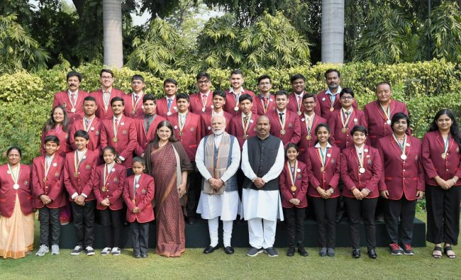 Prime Minister Narendra Modi and Union Women and Child Development Minister Maneka Gandhi pose for a group photograph with the winners of Rashtriya Bal Puraskar - 2019, in New Delhi. (PIB Photo via PTI)