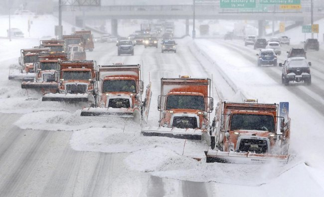 Snow plows clears snow from the westbound lanes of U.S. Highway 12/18 in Madison, Wisconsin. (AP/PTI Photo)