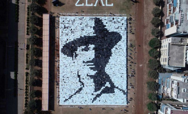 Students hold placards to create a portrait of freedom fighter Bhagat Singh on the eve of Republic day celebration, in Pune, Friday, Jan 25, 2019. (PTI Photo)