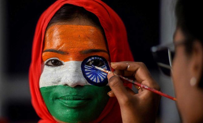 A college student gets her face painted during Republic Day celebrations, in Chennai, Friday, Jan. 25, 2019. (PTI Photo)