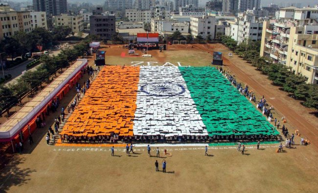 Students form a human chain to resemble the Indian national flag on the eve of the Republic Day in Pune, Friday, Jan 25, 2019. (PTI Photo)